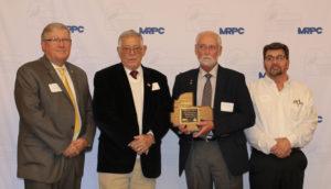 Hartbauer receives outstanding volunteer award.